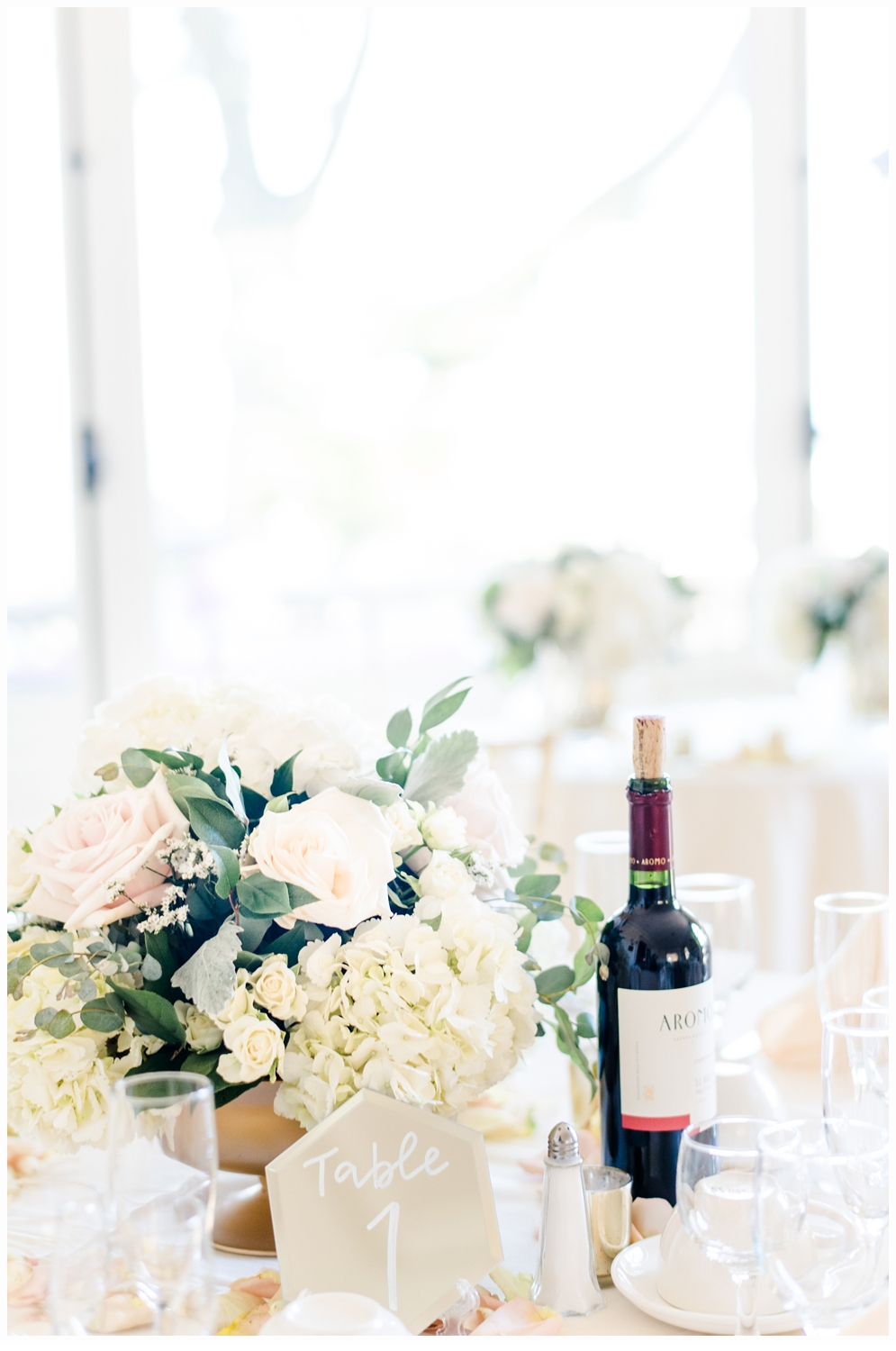 table with flowers and a bottle of wine