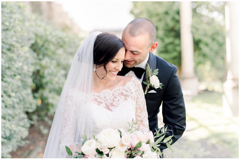 bride and groom on wedding day hugging