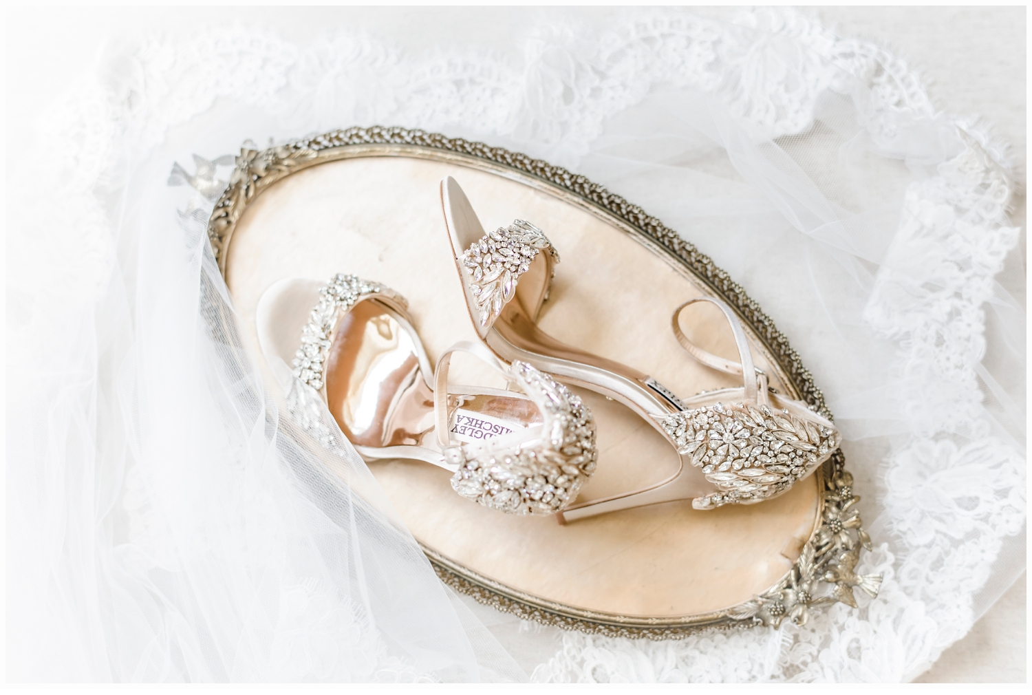 pretty wedding shoes on a gold tray
