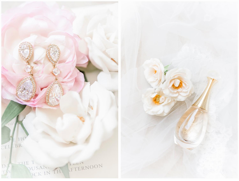 brides earrings and perfume in flowers