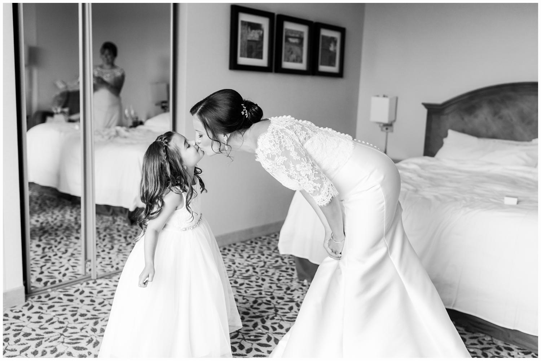 bride and flower girl kissing