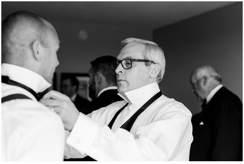groom's dad putting on groom's bow tie