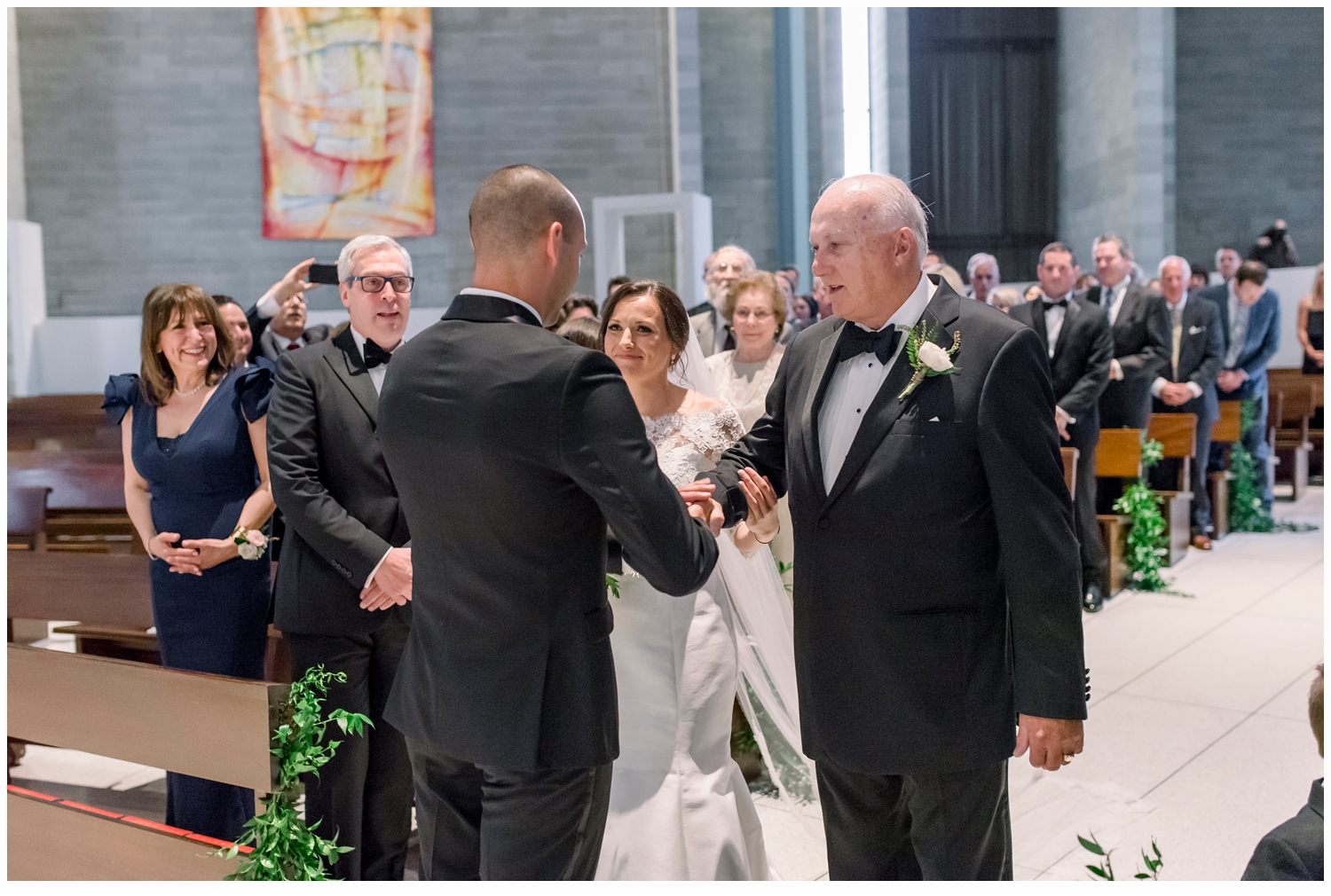 dad giving away bride to the groom