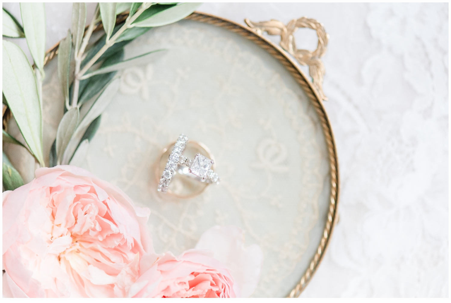wedding rings on pretty antique gold tray