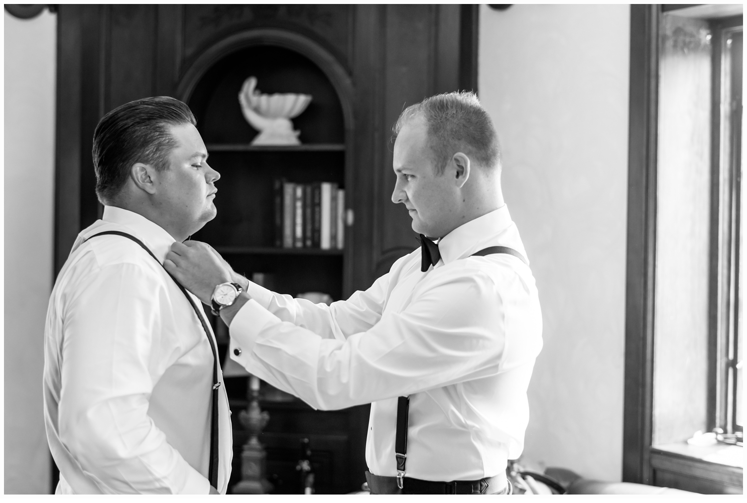 best man and groom getting dressed