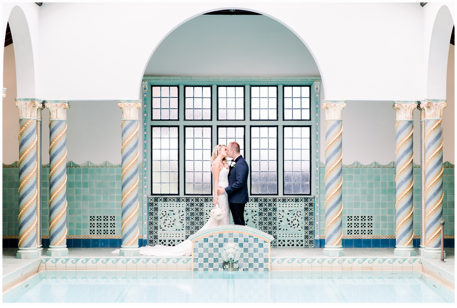 bride and groom portraits at swimming pool