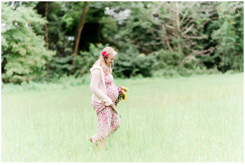 pregnant woman walking in field