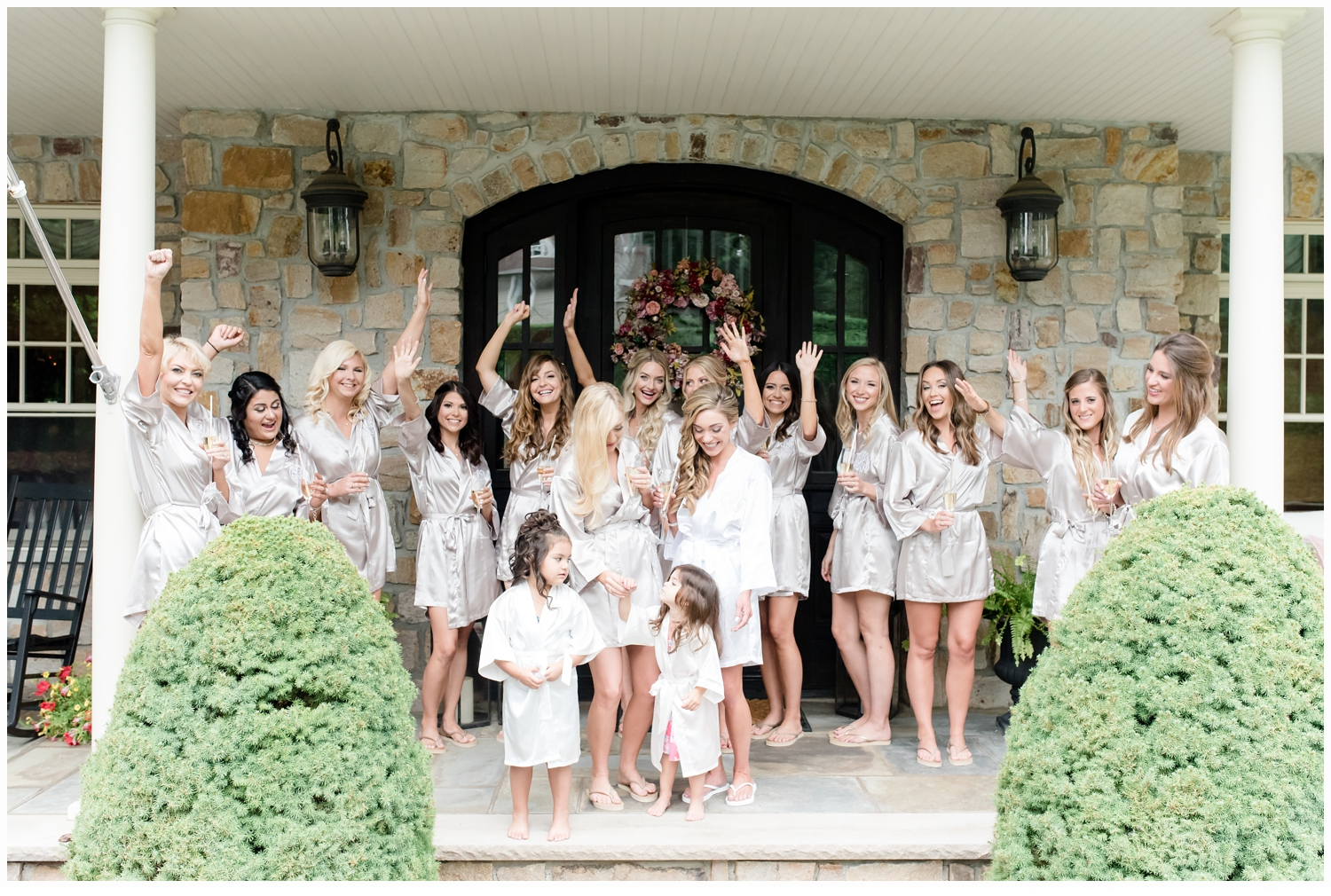 bride and bridesmaids cheering on front porch