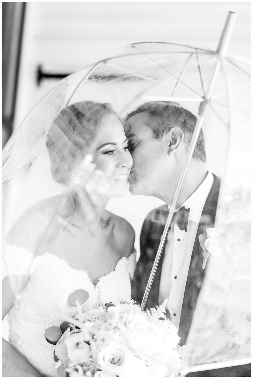 bride and groom portrait under umbrella at parker house spring lake nj