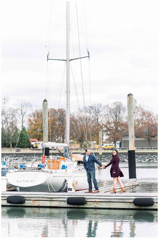 couple holding hands on marina dock