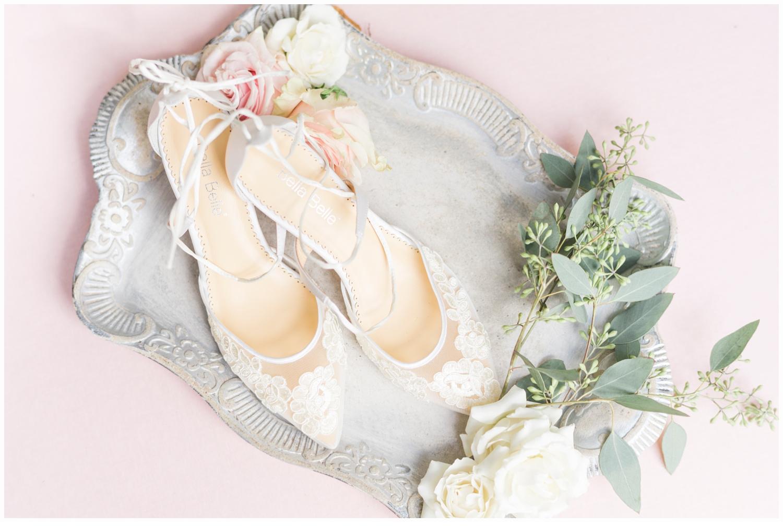 bridal shoes on a pretty tray