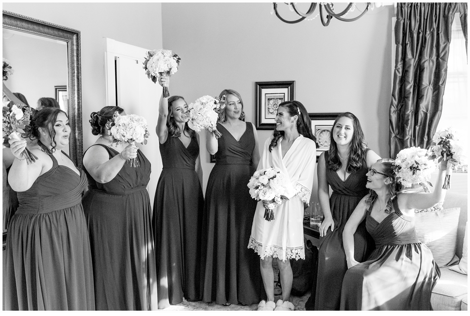 bride and bridesmaid getting dressed
