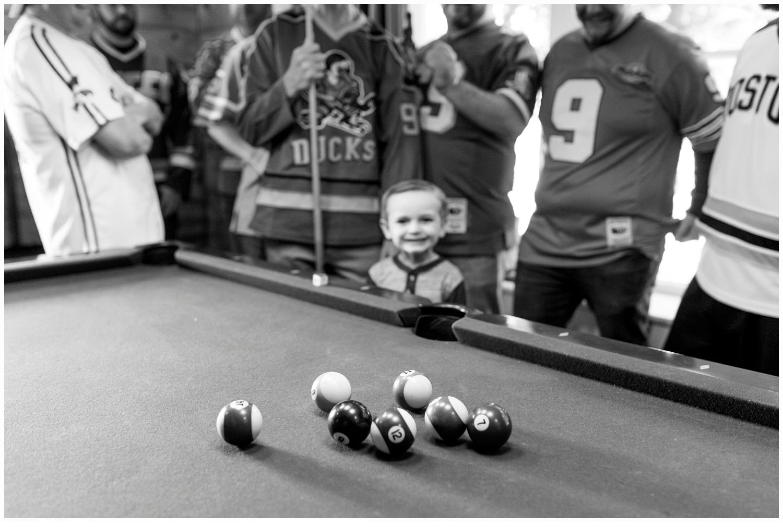 groom and groomsmen playing pool