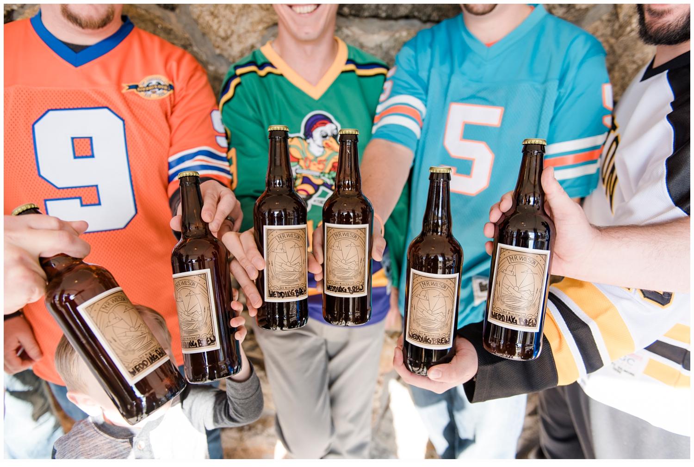 groom and groomsmen cheering with beers