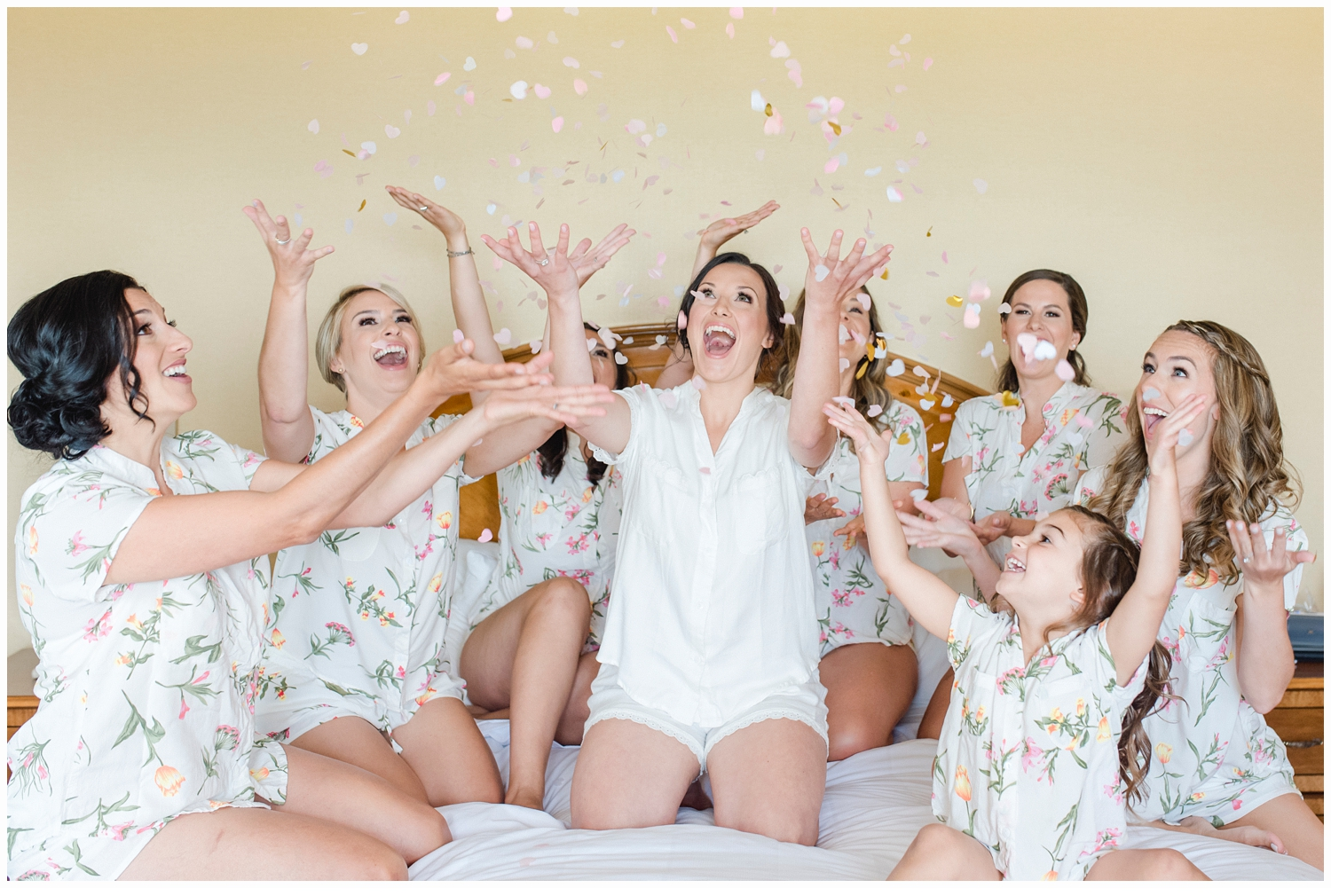 bridesmaids throwing confetti in the air