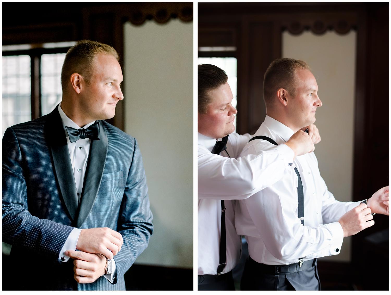 groom and best man fixing tie