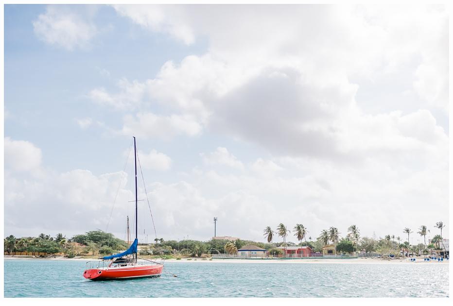 pretty red sailboat in aruba
