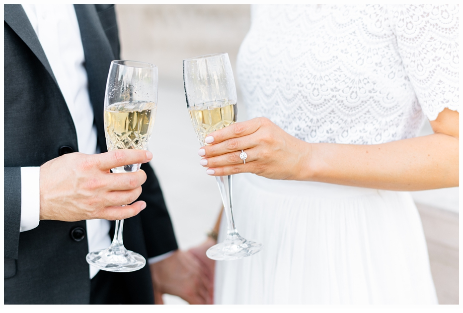 engaged couple with champagne in glasses