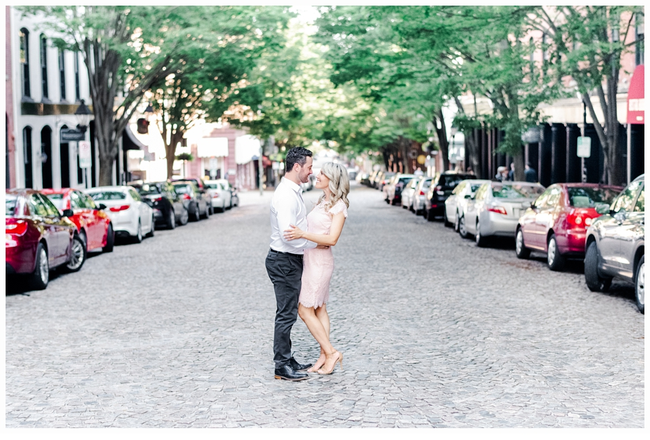 engaged couple  on a cobblestone street in virginia