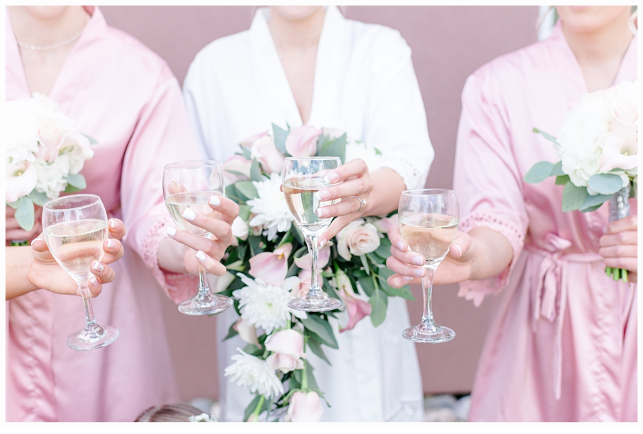 bride and bridemaid's toasting with champagne glasses