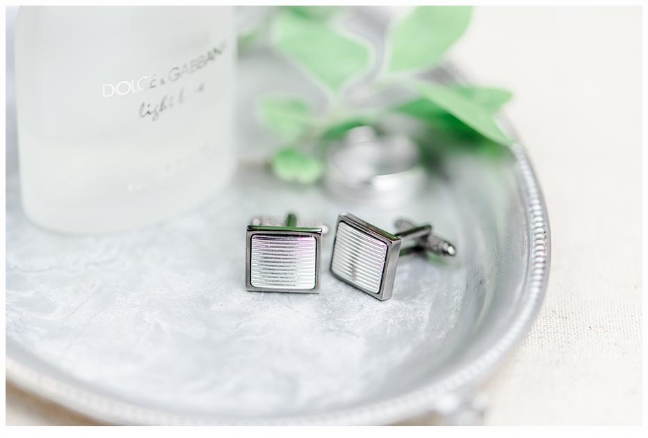 men's cufflings on silver tray