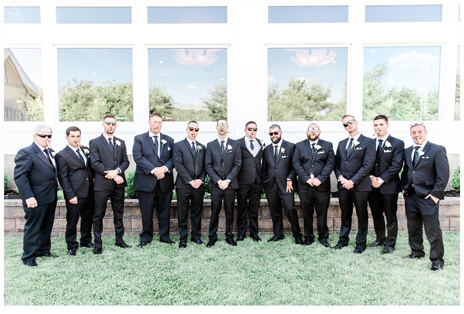 groom and groomsmen smoking cigars