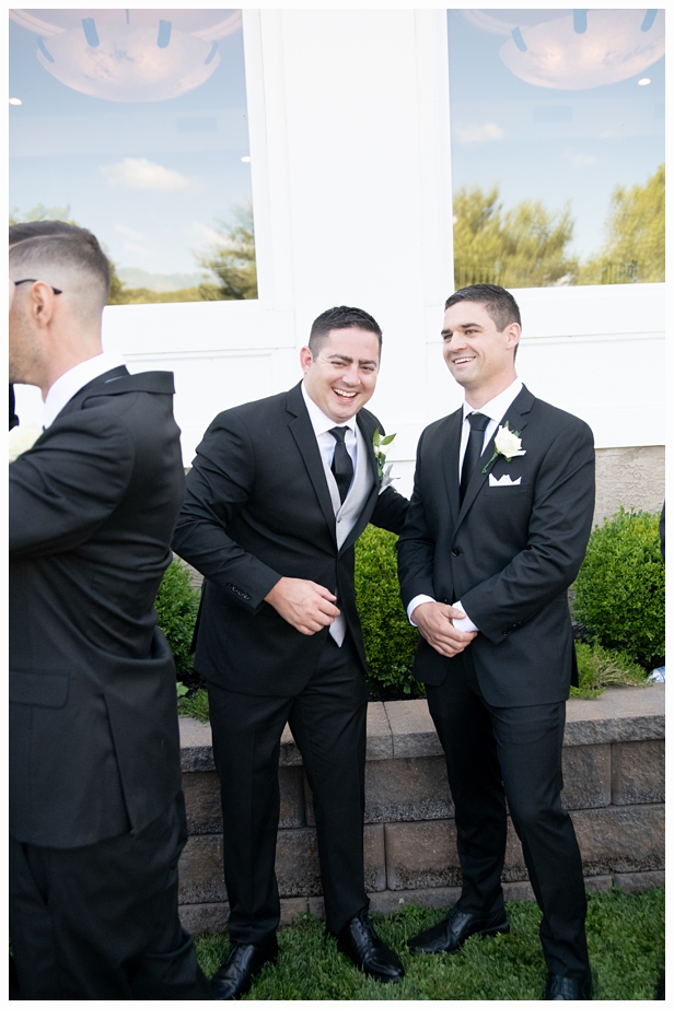 groom laughing with his groomsmen