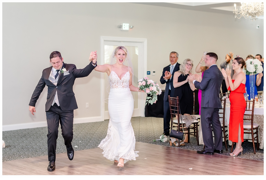bride and groom entering the reception at their wedding