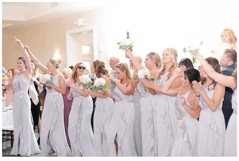bridal party cheering for the bride and groom
