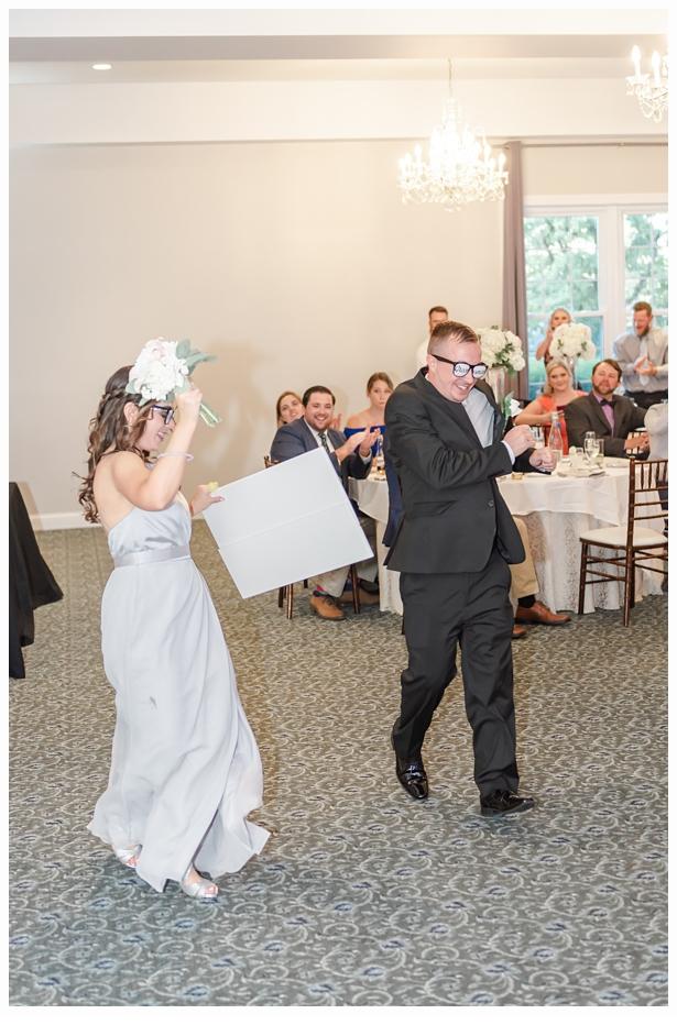 bridesmaid and groomsmen entering reception hall