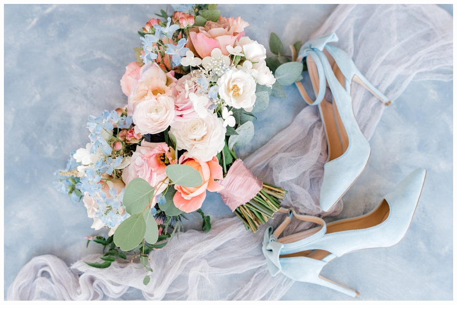 bridal bouquet and blue wedding shoes