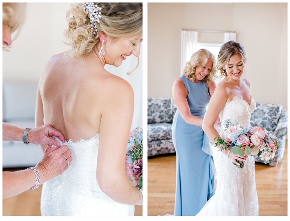 mother of the bride helping her put on her wedding dress