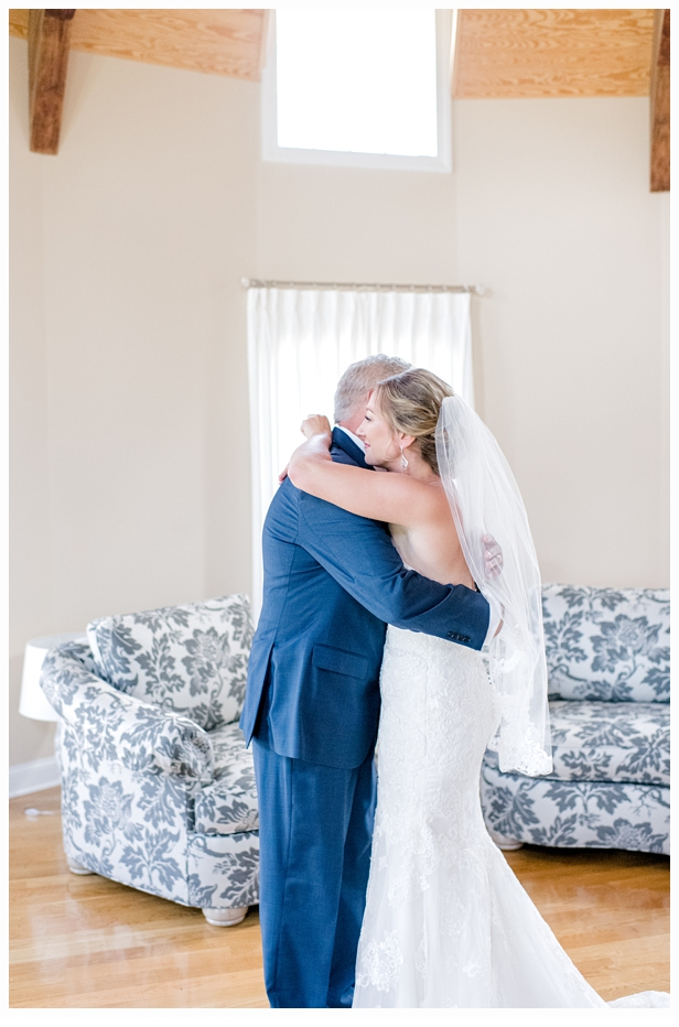 bride and father hugging on wedding day