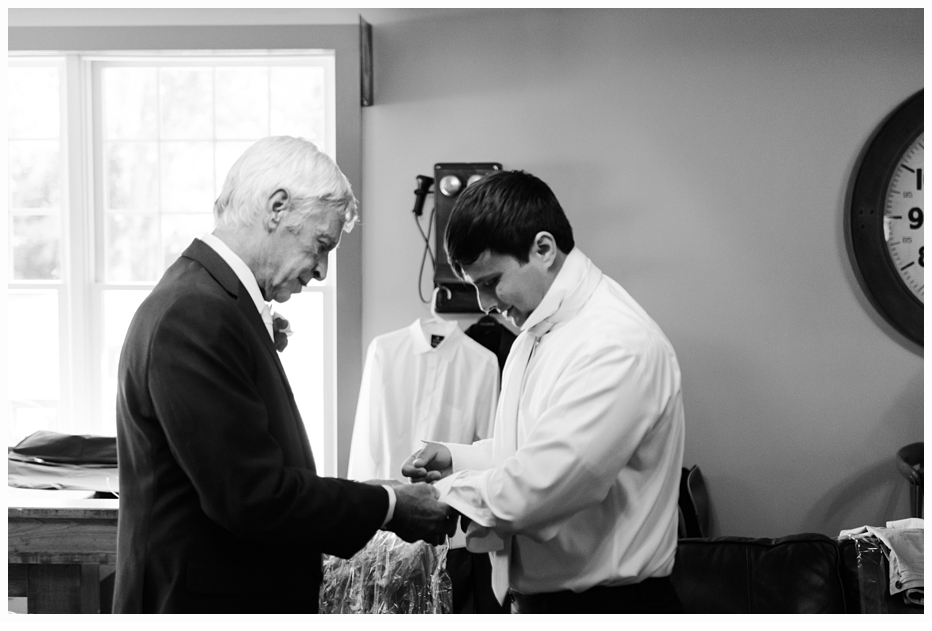 dad helping his son put on his cufflings on his wedding day