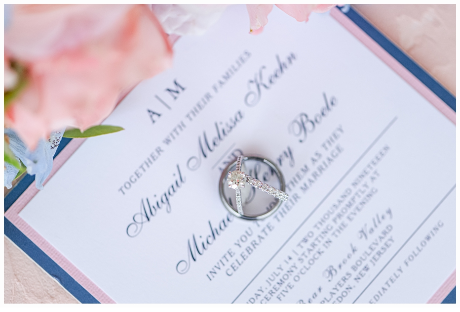 blue and pink wedding invitation with wedding rings