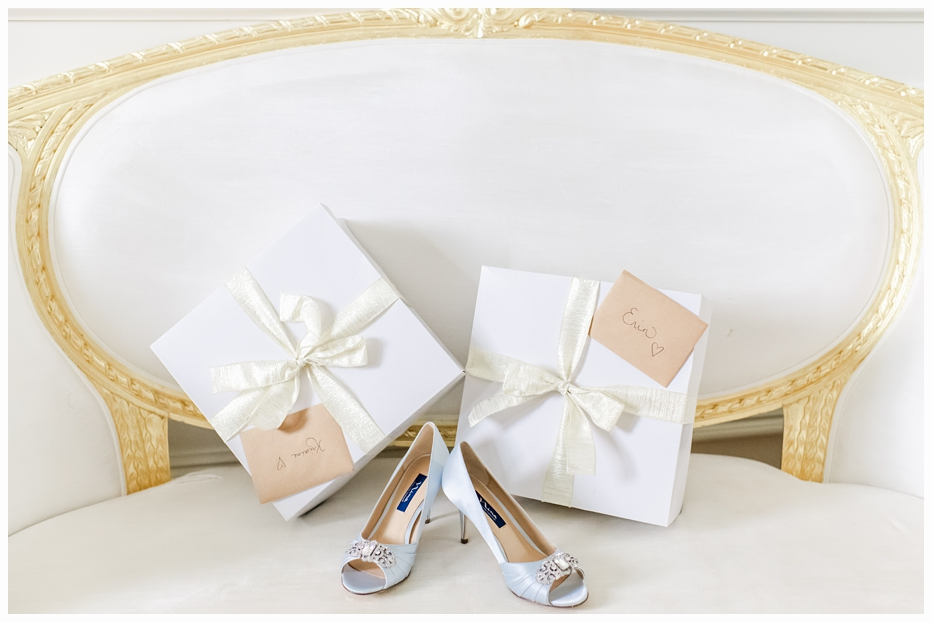 pretty white boxes with gold bows on a white sofa