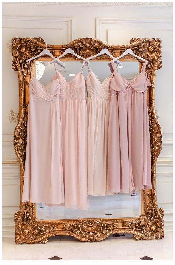 bridesmaids dresses hanging on gold mirror