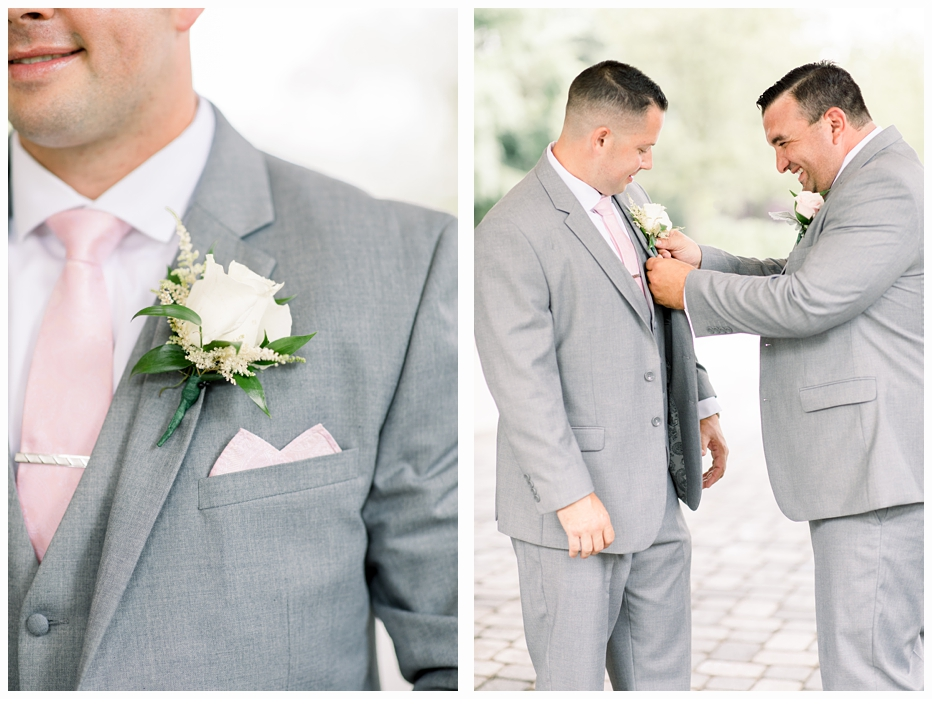 groom and best man putting on his tie