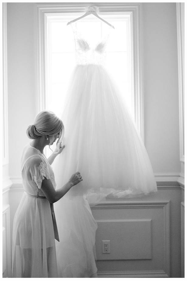 bride touching her wedding gown