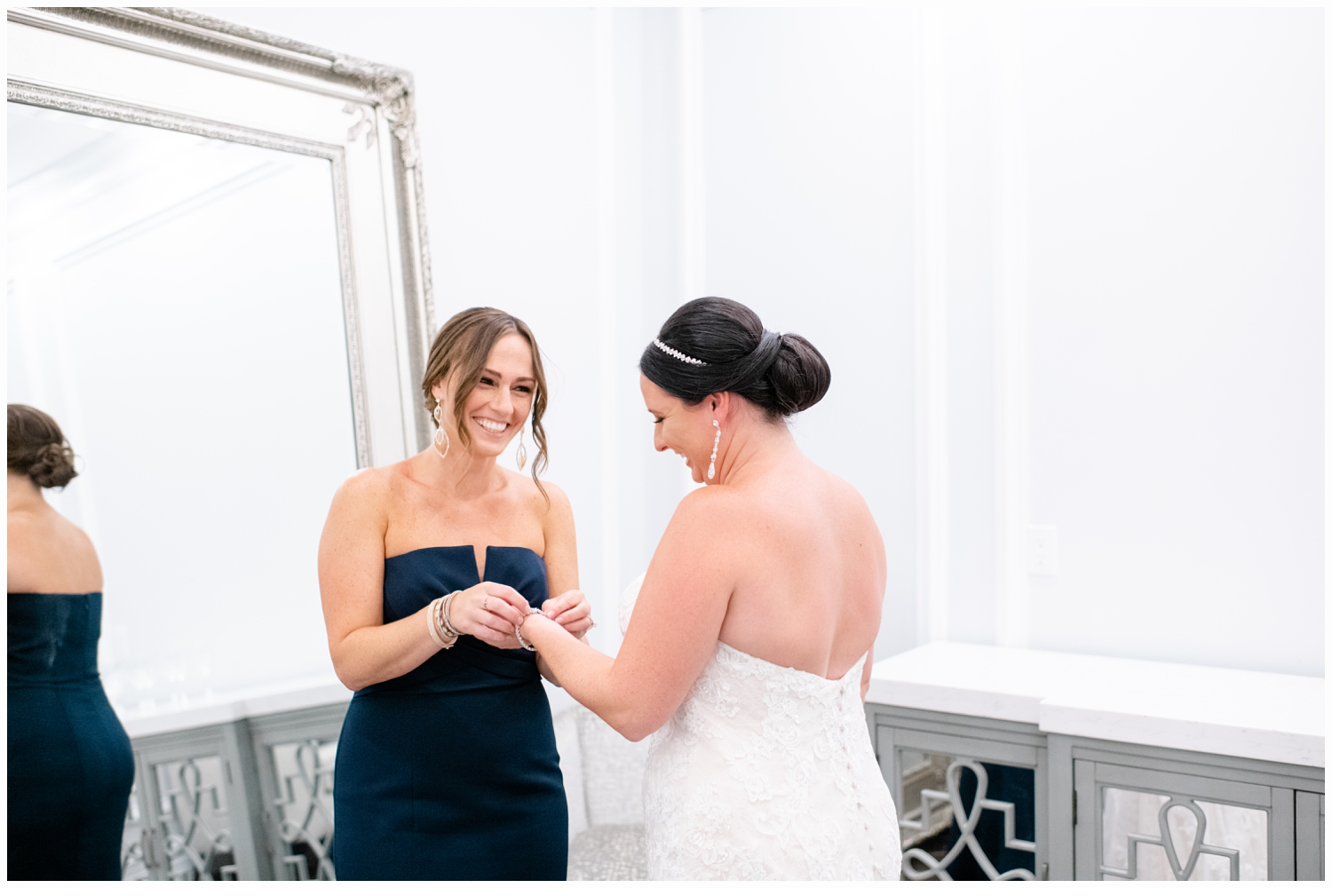 bride and sister in bridal suite getting ready