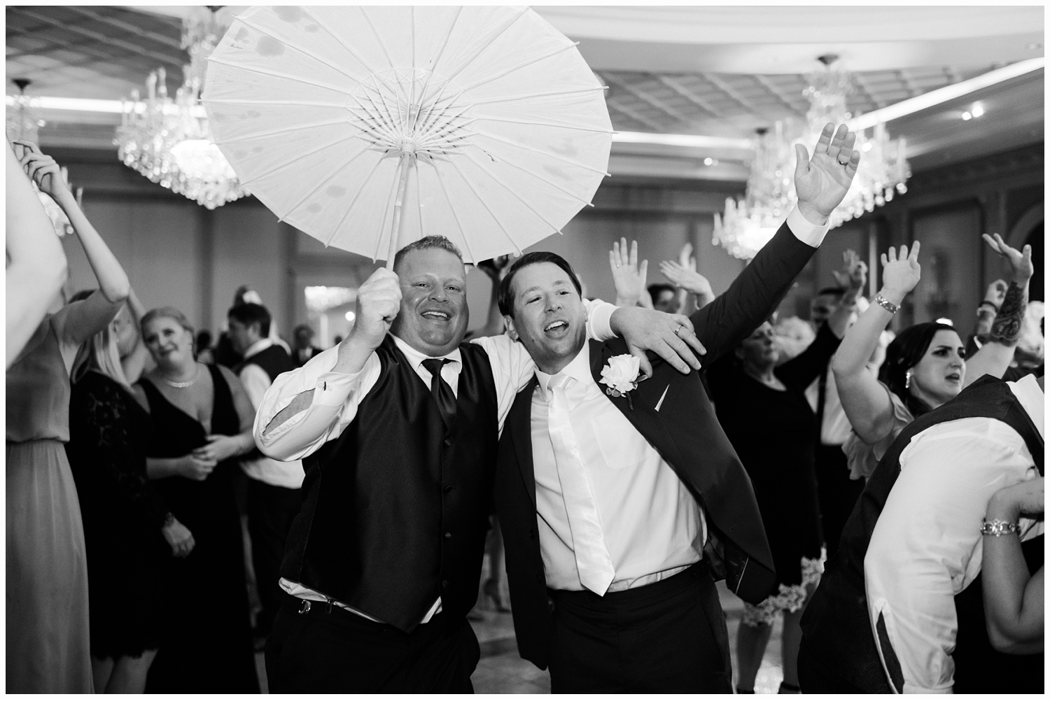 groom dancing with best man at his wedding