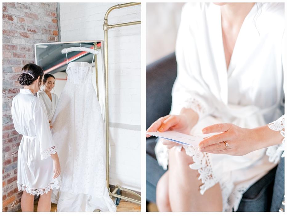 bride hanging up her wedding gown