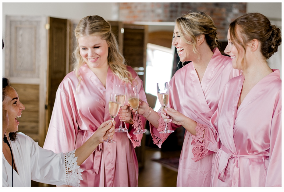 bride and bridesmaids toasting on the wedding day
