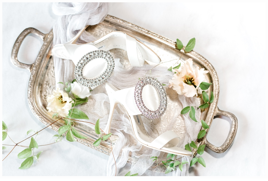 wedding shoes on an antique gold tray
