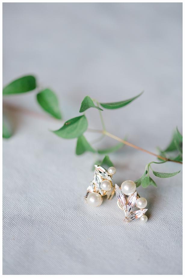 pearl earrings on a green vine