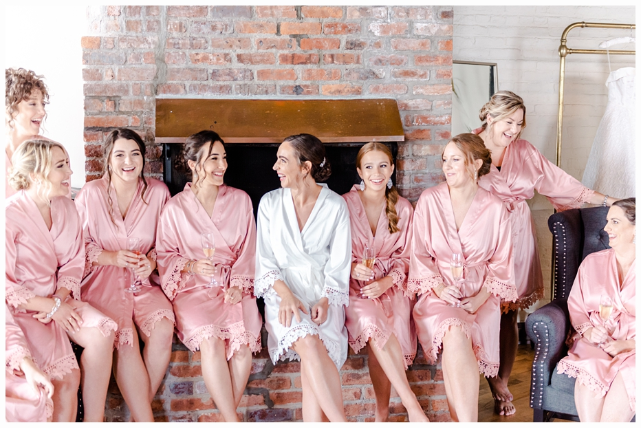 bride and bridesmaids in pretty pink robes