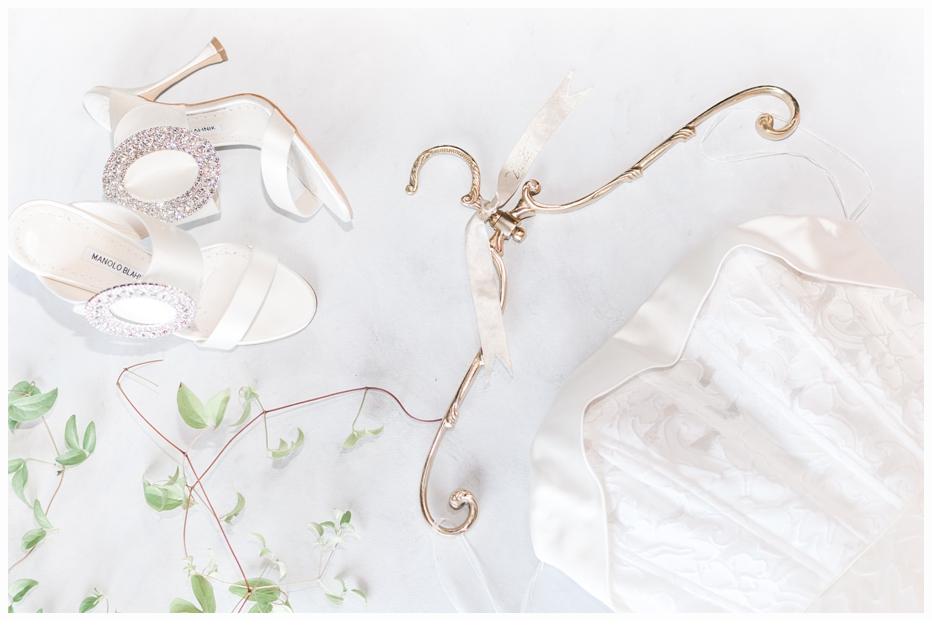 wedding gown on pretty gold hanger