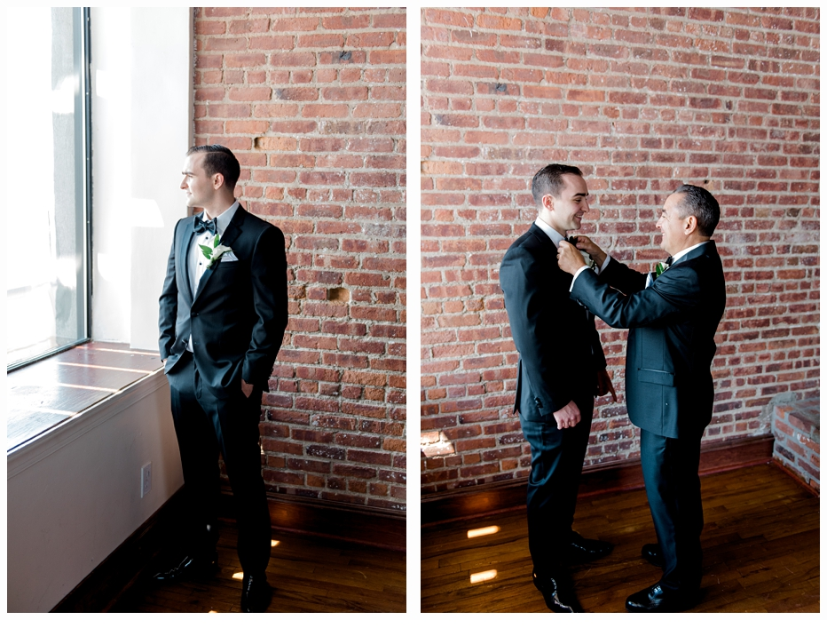 father putting on groom's bow tie