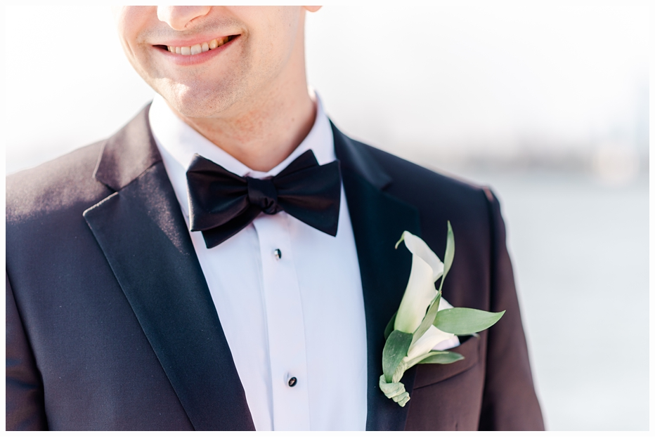 picture of groom smiling wearing a boutonniere