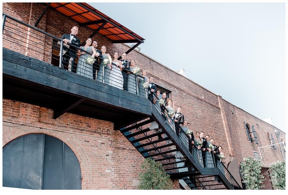 bridal party on steps at libertywarehouse